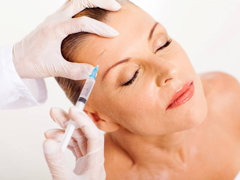 Woman having upper face Botox treatment