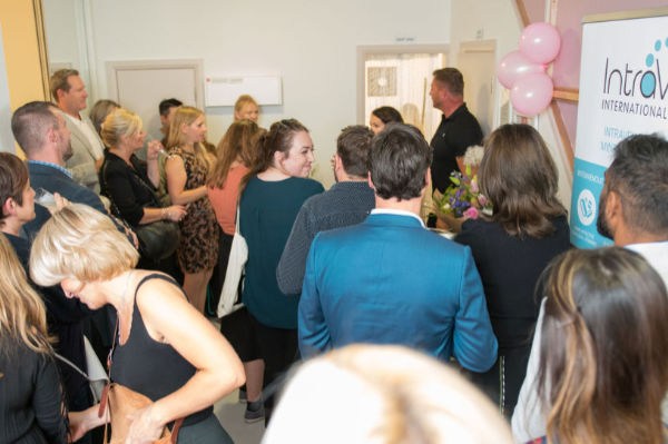 People talking and chatting at the Sloan Clinics launch party in Brighton